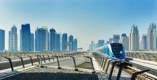 Metro railway and fully automated train in modern and luxury Dubai city,United Arab Emirates. View on financial center in Dubai Royalty Free Stock Images