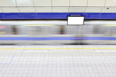 Metro railway station with motion train Stock Image