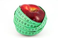 Manzana y metro rojos Foto de archivo
