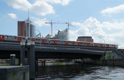 Metro runs over canal bridge in front of HafenCity Royalty Free Stock Photos
