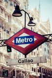 Metro Sign on blurred city, Madrid Stock Photography