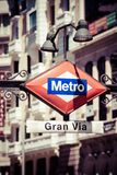 Metro Sign Gran Via on blurred city, Madrid Royalty Free Stock Photography