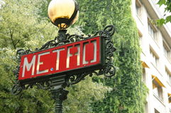Metro sign. In a lamp pole in a street of Paris, over a green background Royalty Free Stock Image