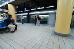 Metro station. Sydney metro station, blurred train, passengers waiting,wide angle shot Royalty Free Stock Photo