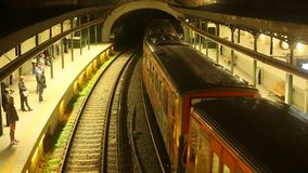 Metro station with departing train. ATHENS, GREECE - MAR 23, 2015: Urban metro station with departing train. The Athens Metro is a rapid-transit system opened stock video footage