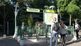 Metro station entrance in Paris. Tourists looking the map in a metro station entrance in Paris stock video