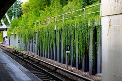 Metro station with falling plants in Berlin, Germany. stock photos