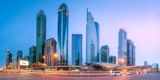 Metro station in Financial district Dubai, UAE. Panoramic view of metro station and road in Financial district during overcast day, Dubai, UAE royalty free stock photo