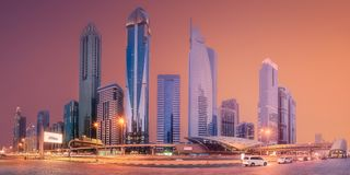 Metro station in Financial district Dubai, UAE. Panoramic view of metro station and road in Financial district during overcast day, Dubai, UAE. Clipping path of royalty free stock image