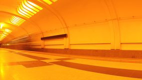 Metro station interior and moving train Royalty Free Stock Photo
