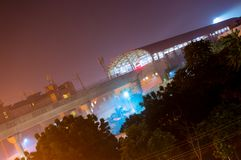 Metro station at night with trees, city lights of Jaipur. Metro station of Mansarover jaipur with the city lights, trees, and purple light. The new jaipur metro Stock Images