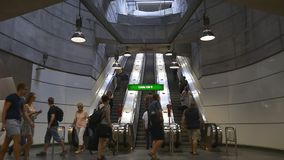 Metro station, people going up and down the escalator. VIENNA, AUSTRIA - AUGUST 2016: U-bahn metro station, people going up and down the escalator stock footage