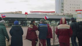 Metro station staff stand near entrance of new metro station. In moscow stock video