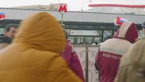 MOSCOW - CIRCA APRIL, 2018: Metro station staff stand near entrance of new metro station. Metro station staff stand near entrance of new metro station in moscow stock footage