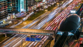Metro Station with traffic on the highway timelapse in Dubai, UAE. Metro Station with traffic on the highway night timelapse in Dubai, UAE. The Dubai Metro runs stock footage