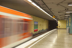 Metro station with train in Motion Royalty Free Stock Photo