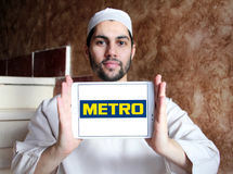 Metro stores logo. Logo of the international chain of convenience stores metro on samsung tablet holded by arab muslim man Royalty Free Stock Photography