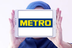 Metro stores logo. Logo of the international chain of convenience stores metro on samsung tablet holded by arab muslim woman Royalty Free Stock Image