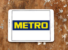 Metro stores logo. Logo of the international chain of convenience stores metro on samsung tablet on wooden background Royalty Free Stock Photos