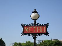 Metro or subway sign with  round lamp in the centre of Paris royalty free stock photos