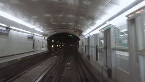 Metro subway station POV from moving train. Underground station of metro subway tube POV from moving train arriving to station stock video