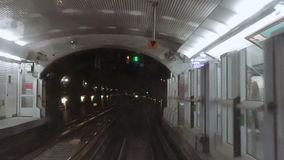Metro subway station POV from moving train. Underground station of metro subway tube POV from moving train arriving to station stock footage