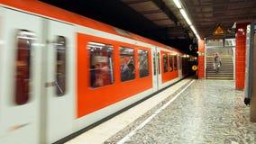 Metro subway train arrives to station. Hamburg, Germany - October, 10, 2016: Metro subway train arrives to station. People at subway metro underground tube Royalty Free Stock Photography