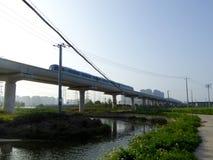 A metro track passing a river Stock Photos