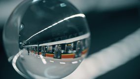 Metro train arriving at the station as seen through the glass ball. Metro train arriving at the station stock video footage