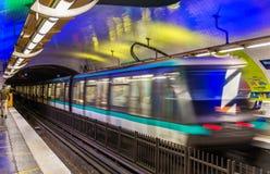 Metro train leaving Montparnasse - Bienvenue station in Paris, France Royalty Free Stock Photos