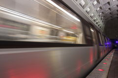 Metro train leaving the station. A metro train speeds away in Washington's underground subway system Royalty Free Stock Images