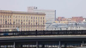 Metro train moves bridge over the river in the city of Moscow stock footage