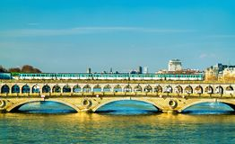 Metro train on the Pont de Bercy, a bridge over the Seine in Paris, France. Metro train on the Pont de Bercy, a bridge over the Seine in Paris, the capital of Stock Photos