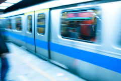 Metro train travels at high speed Stock Photo