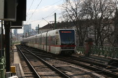 Metro train at U6 line in Vienna Wien. Train heading to Siebenhirten going on rails under the sky Stock Photos
