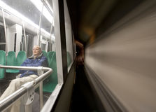 Metro traveler. Man, sitting alone in a metro, driving at speed through a tunnel royalty free stock image