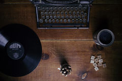 Metro Vinyl Disc on Brown Surface Along With Black Typewriter and Scrabble Tiles Stock Image