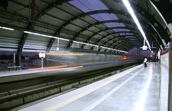 Metro zooming past station, delhi Stock Photo