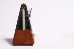Metronome. Isolated on white background Stock Photo