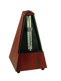 Metronome. Isolated on a white background Stock Images