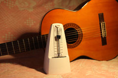 Metronome with classical guitar. It s a wonderful picture,metronome with classical guitar Stock Photo