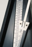 Metronome closeup. Enphasis on the tempo Royalty Free Stock Images