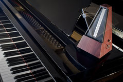 Metronome on a grand piano Royalty Free Stock Photos