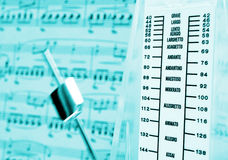 Metronome & music score Royalty Free Stock Photos
