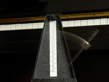 Metronome on the piano. Metronome running on the piano Stock Photography