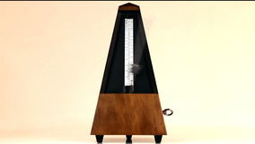 Metronome On Table With Arm Moving At Allegro Tempo stock footage