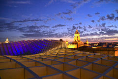 Metropol Parasol. Of Seville, Spain. Shot at sunset. Lanscape, beautiful colors of purple, gold and pink Stock Image