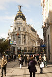 Metropolis. Building in Grand Via with people walking - Madrid christmas 2007 Royalty Free Stock Images