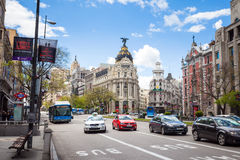 Metropolis Building and Grassy Building, Madrid Stock Photos