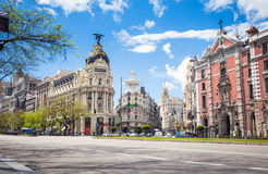 Metropolis Building and Grassy Building, Madrid Stock Photo